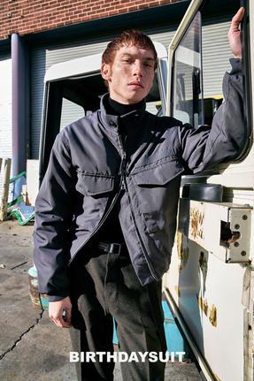 Model in Gray Jacket