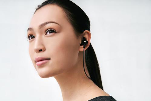 Women Wearing Earphones
