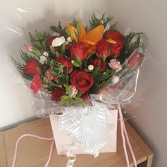 red roses & orange lilies gift bag bouquet - fresh flowers