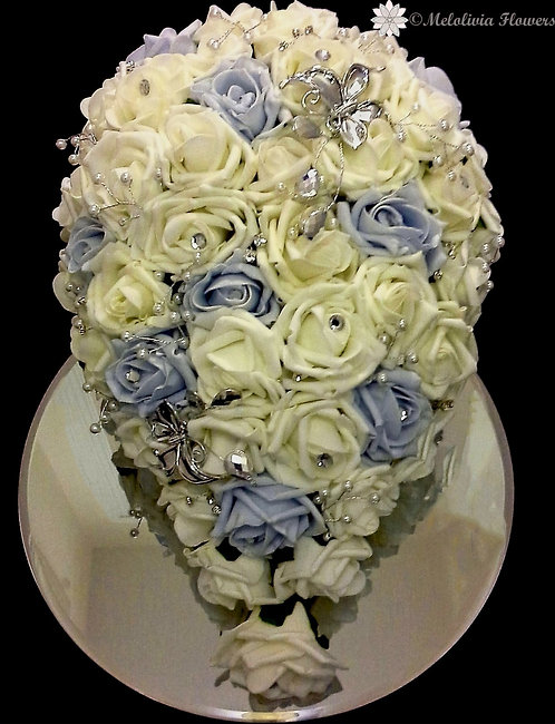 Artificial teardrop bridal bouquet with embellishments and butterflies