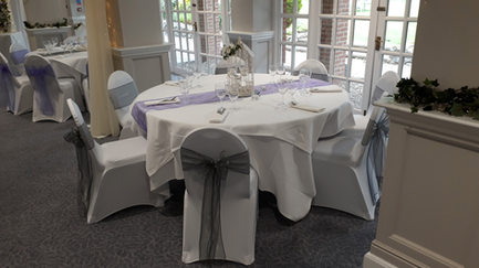 White, silver and lilac wedding breakfast/reception.