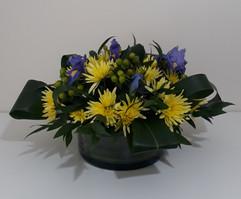 yellow chrysanthemum & iris in glass container - fresh flowers