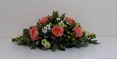 orange roses table arrangement - fresh flowers