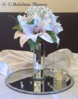 pink lillies in mirror vase - artificial flowers