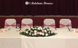 pink & white top table arrangement - foam flowers