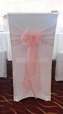 White chair with blush pink sash