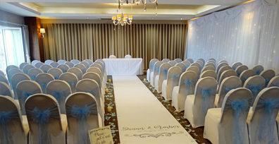 White and light blue ceremony room.