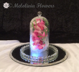 pink orchids in bell jar - artificial flowers
