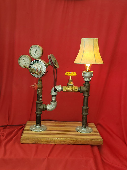 Pulley and Pipes with gauge cluster and lamp shade