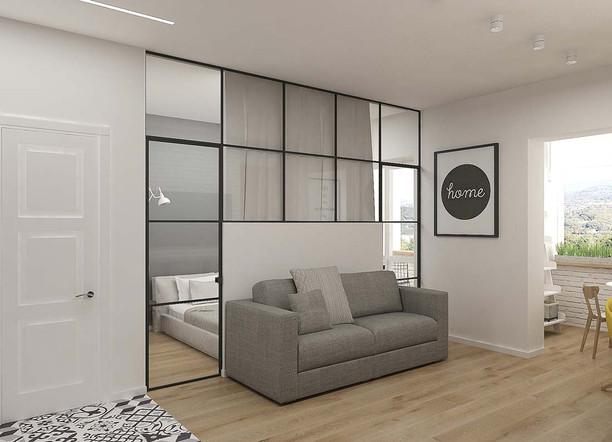 Диван серого цвета в интерьере гостиной