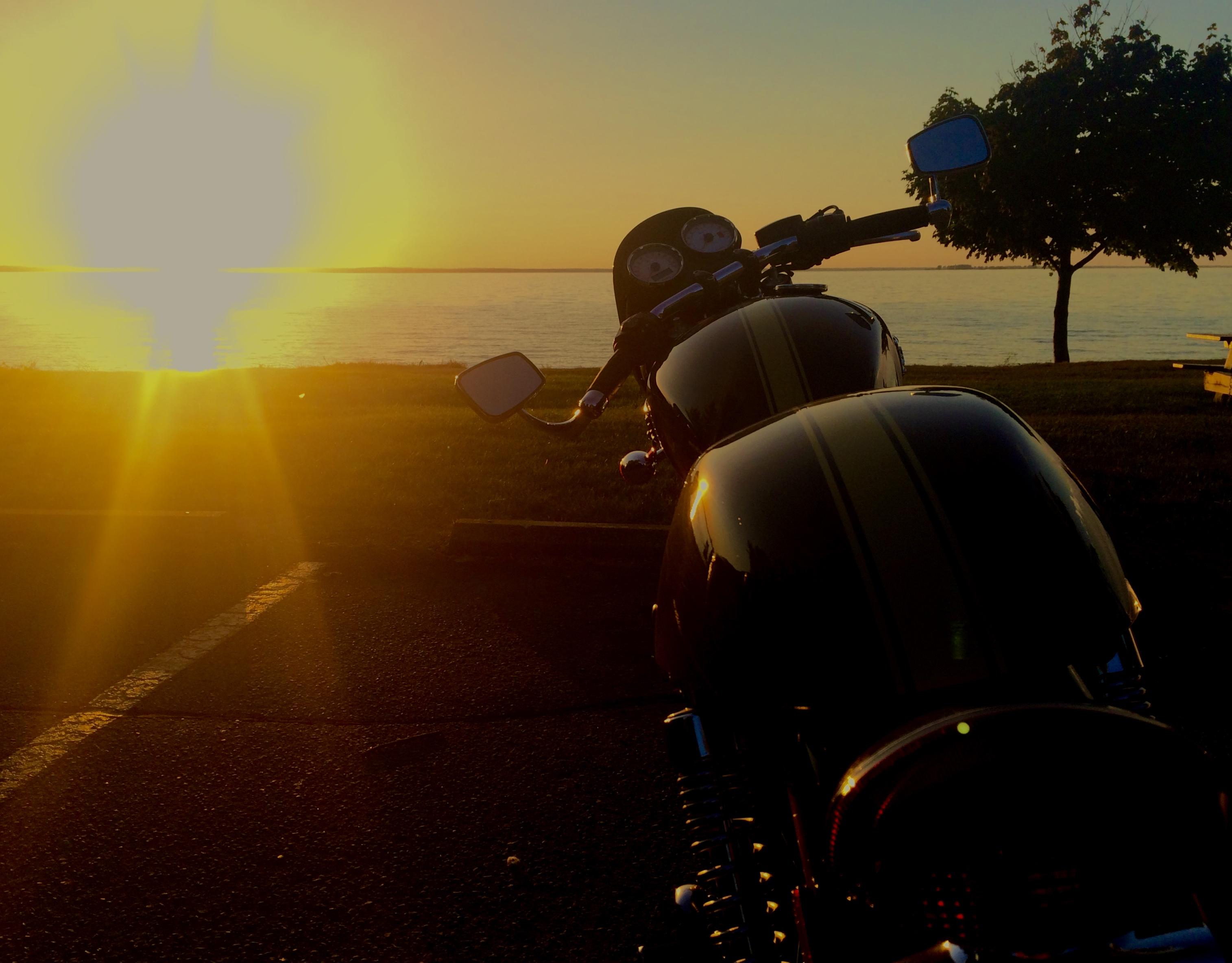 Triumph Thruxton by Green Bay sunset