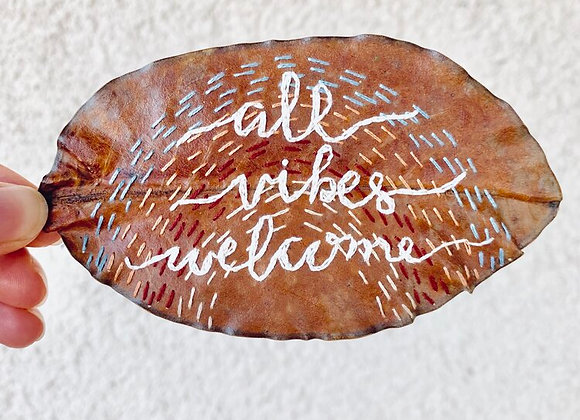 """""""All Vibes Welcome"""" Embroidery on Magnolia Leaf"""