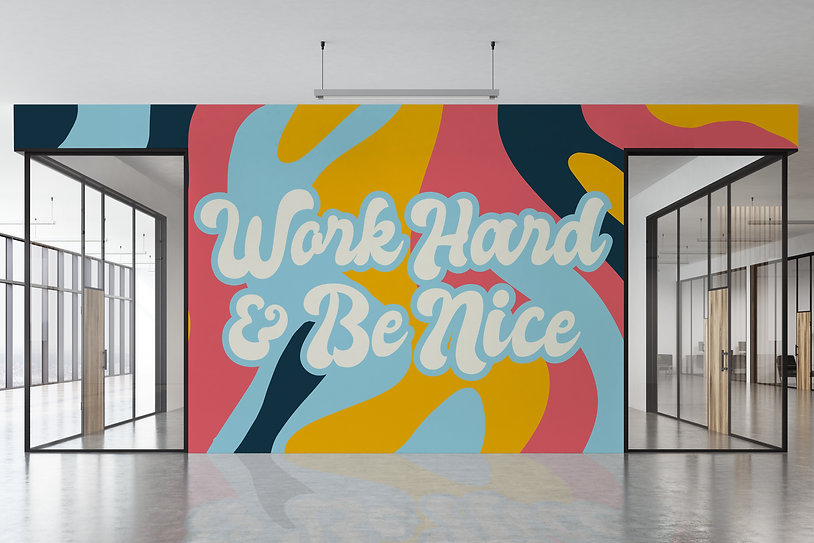 Seventies white lettering that says Worl Hard & Be Nice, with background of light blue, yellow, coral, and navy blue. Set in an office building