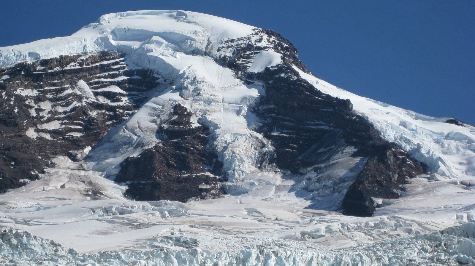 Our route starts with the ice on the left of the rock triangle and meets up with the othr side above