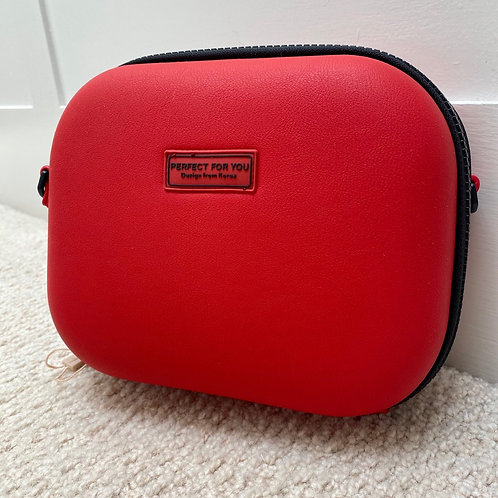 Red cross body handbag