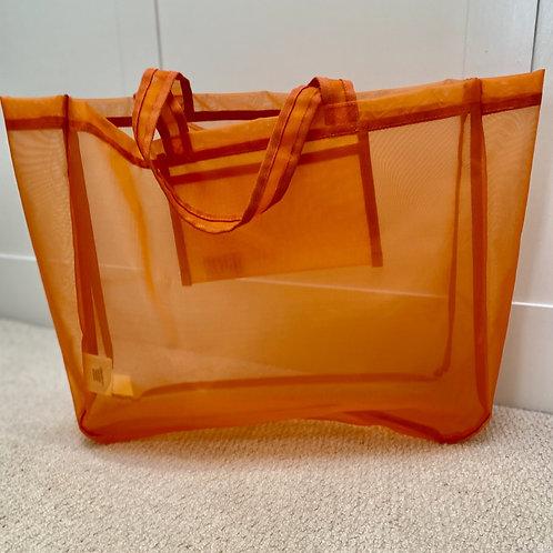 Bright orange hairnet Joy bag