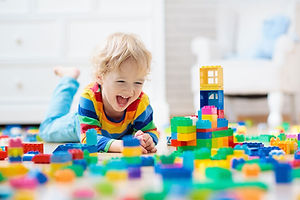 child-happy-playing-min.jpg