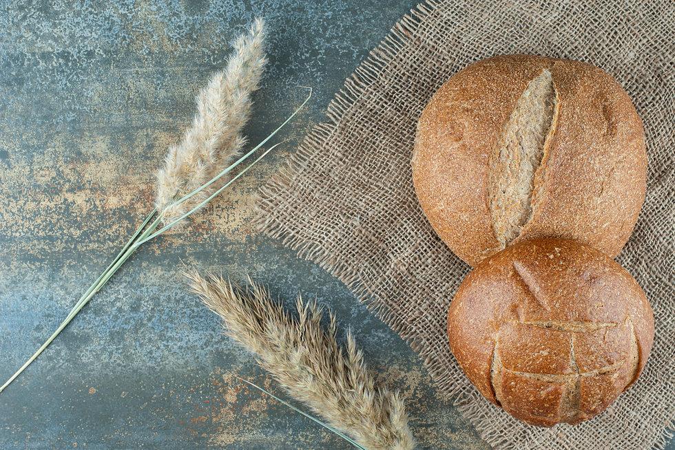 two-fresh-brown-bun-with-wheat-sackcloth