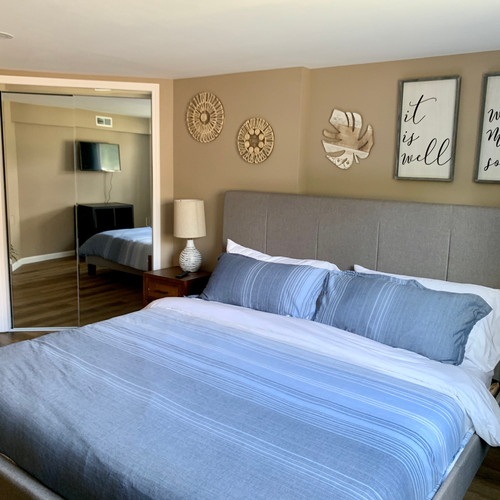 King Sized Bed in a spacious bedroom with a large window