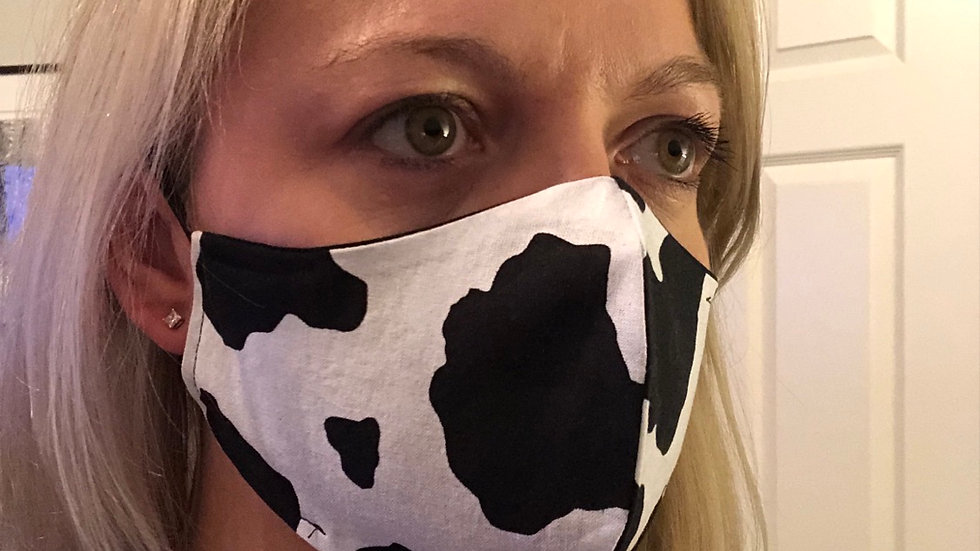 Reversible black and cow print masks
