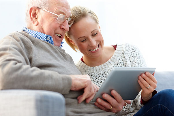 Elderly father and daughter viewing TextCare home monitoring online portal on an iPad