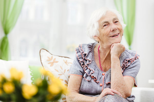 Happy elderly woman living in her own home with dementia and TextCare home monitoring