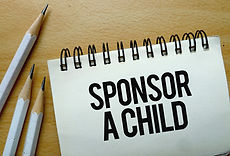 Sponsor A Child text written on a notebo