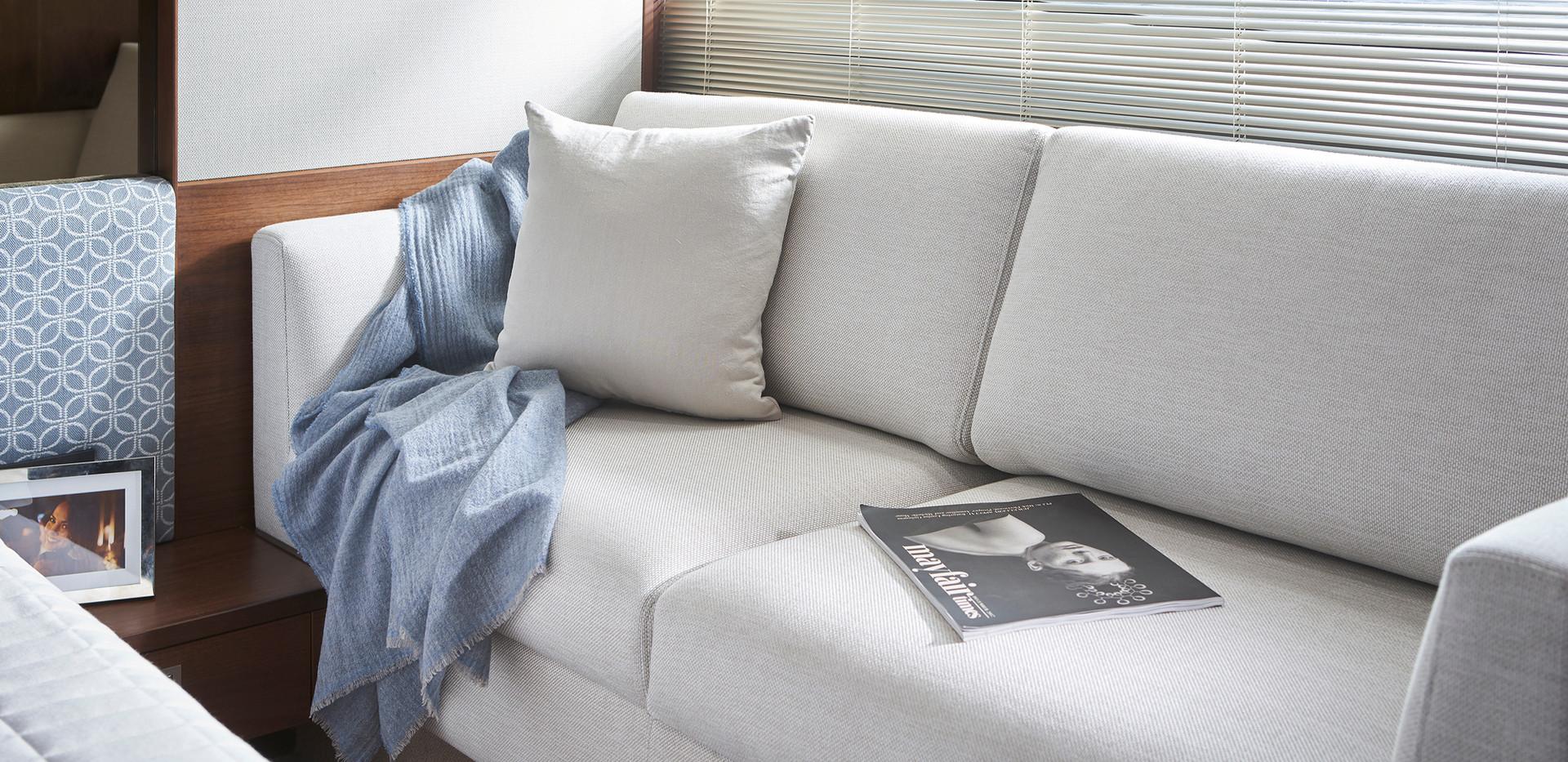 f50-interior-owners-stateroom-sofa-walnu