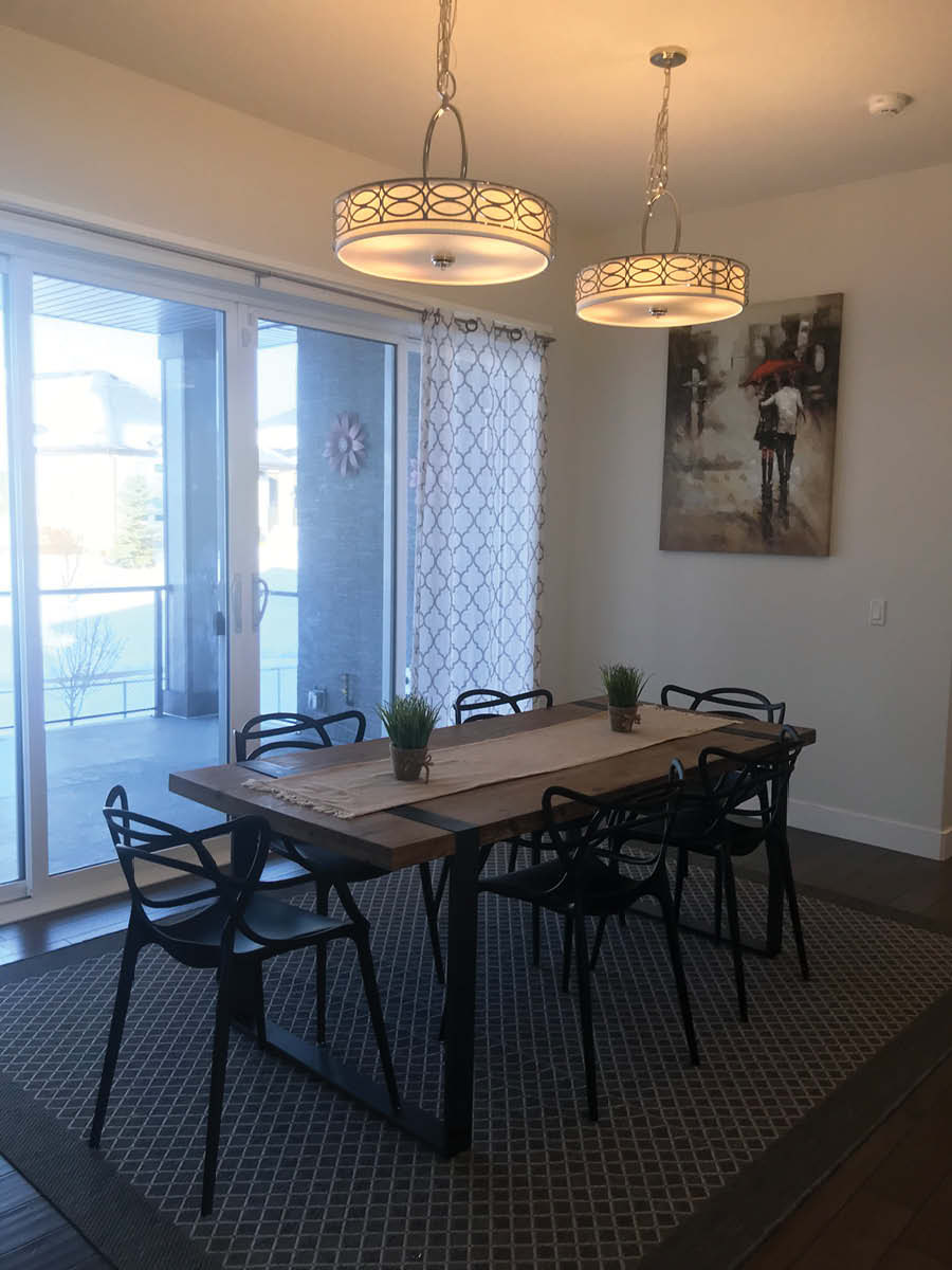 Dining Room Makeover   Home Staging   Small Dining Table with Two Hanging Lights Beside Patio Door