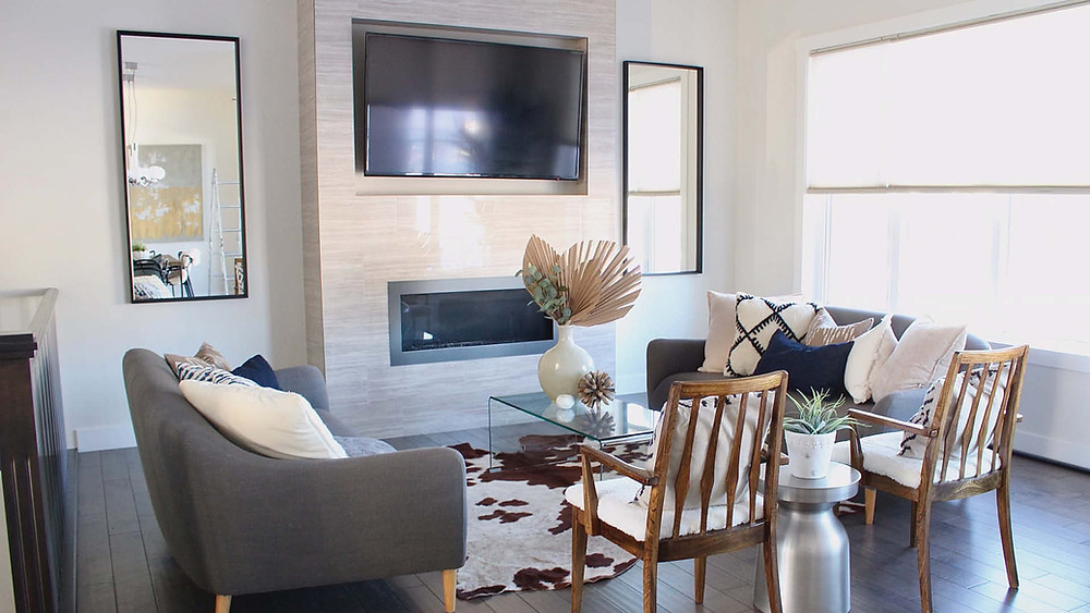 Staged Living Room   Floor to Ceiling Fireplace with Two Couches and Two Chairs Surrounding