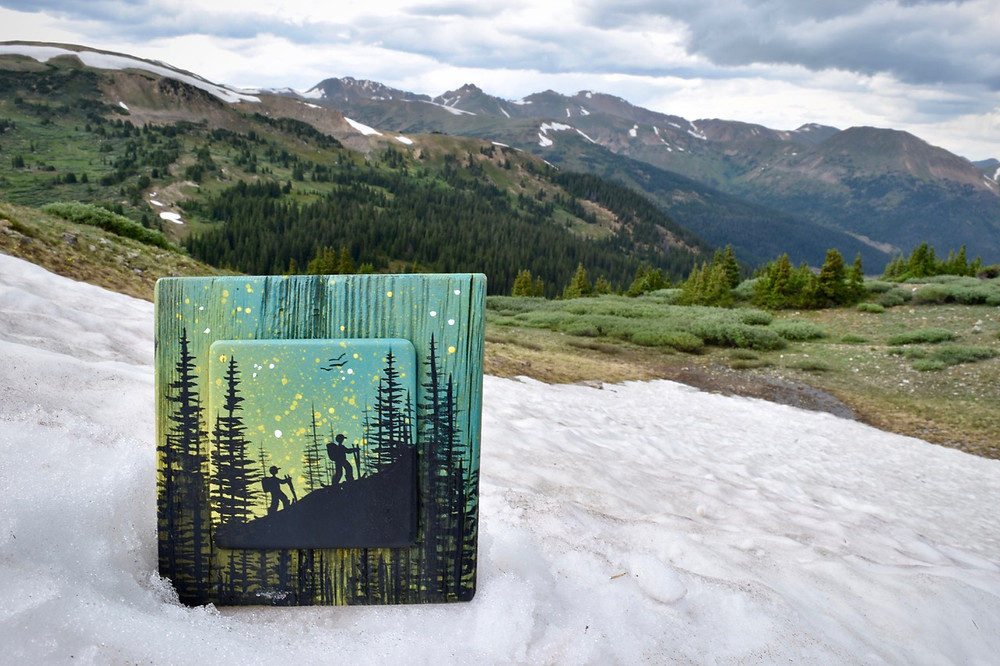 Basin Reclaimed depicts hikers on reclaimed wood