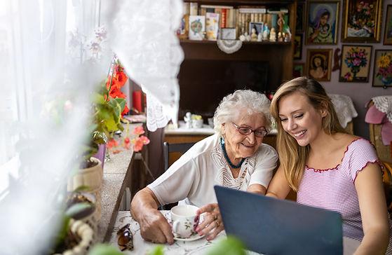 Adult granddaughter teaching her elderly