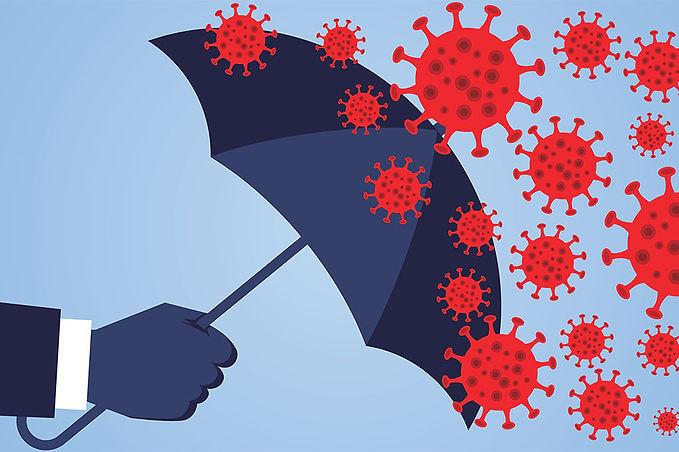 hand holding umbrella against coronaviru