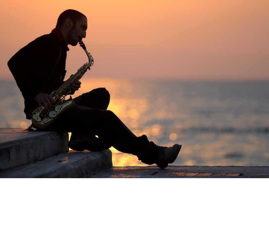 Saxophonist relaxing sunset