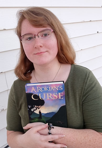 Self-published author, Krista Jain posing with her debut novel.
