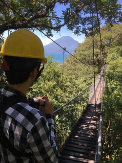 Hanging bridge and volcano
