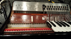 Accordion repair. Service on piano keyboard side. Complete key removal, cleaning