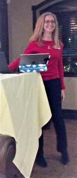 Linda speaking at the dinner