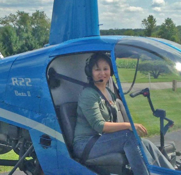 Diane flying the R22