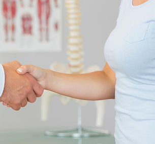 Concierge Physical Therapy Practice, Doctor and client shaking hands with a spine in background