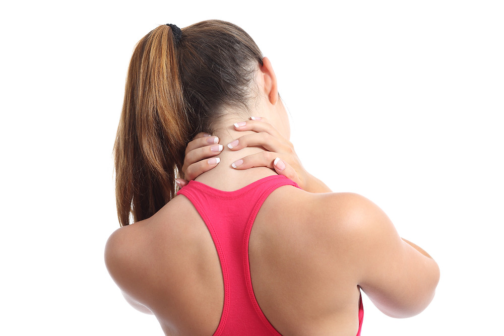 Woman in pain holding her neck in Physical Therapy