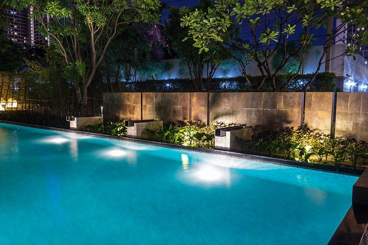 Pool lighting in backyard at night for f
