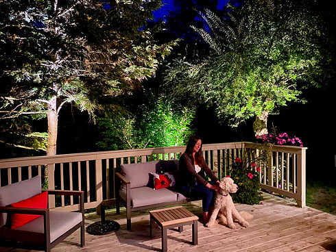 Apex Outdoor Systems, Woman with Dog, Outdoor Lighting, Toronto, Oakville