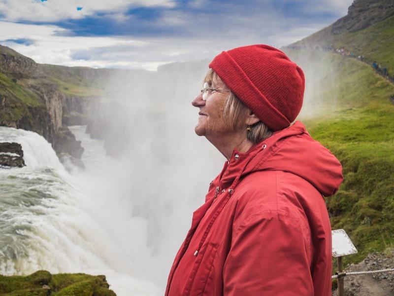 A female tourist enjoying the Golden Circle senior tour in Iceland