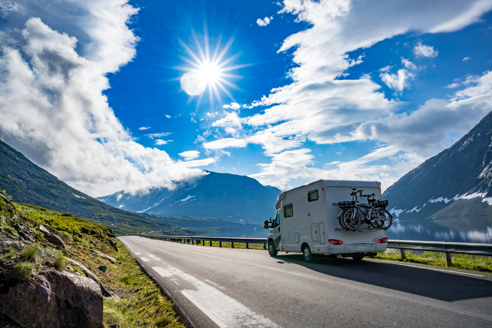 An RV driving in Norway on a sunny day