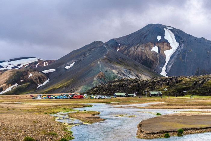 A magnificent view on Brennisteinsalda camping in the Landmannalaugar area with the view on mountains covered with some snow