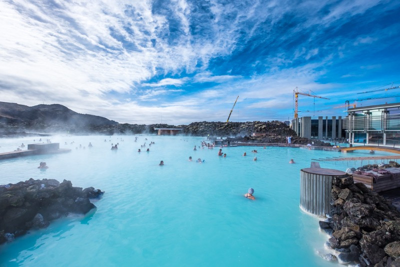 People enjoying the Blue Lagoon in Iceland in a sunny day