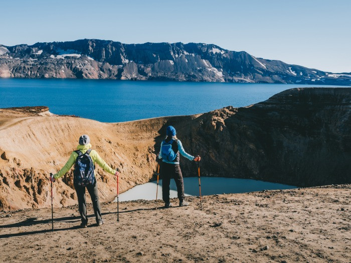 A couple of turists exploring Askja volcano in the Highlands