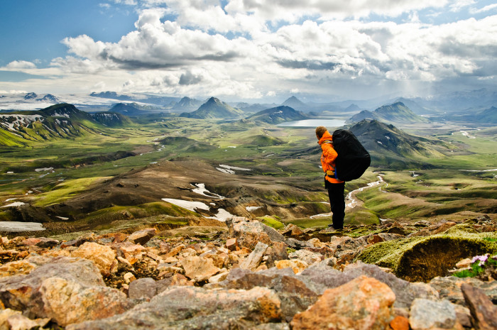 A tourist male watching the Landmannalaugar mountains