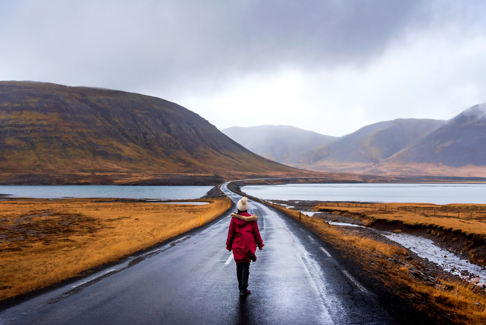 A female tourist enjoying great autumn activities in Iceland